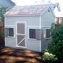 Playhouse with loft painted to match the house